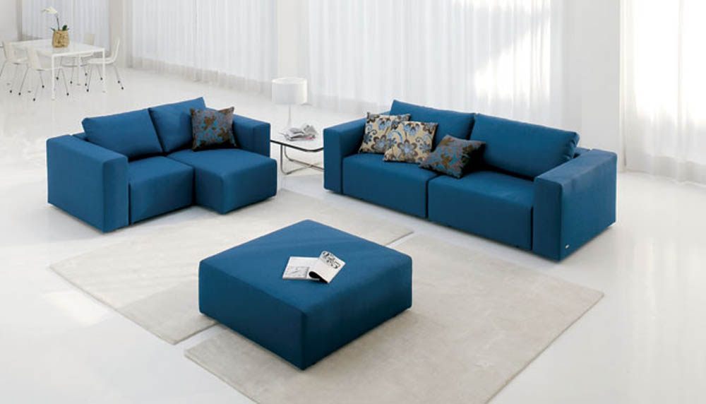 Inspired interiors reflections modern sofas available in for Modern style sofa