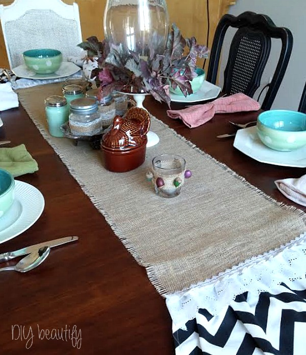 Burlap table runner and DIY acorn votives at www.diybeautify.com