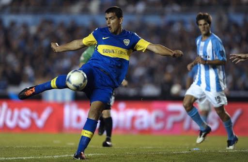 Boca Juniors player Lucas Viatri kicks the ball to score against Racing Club