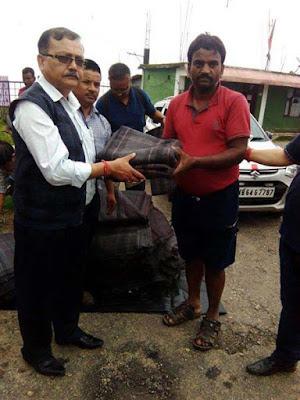 Kurseong MLA Dr. Rohit Sharma distributing relief material to tingling mirik landslides victims
