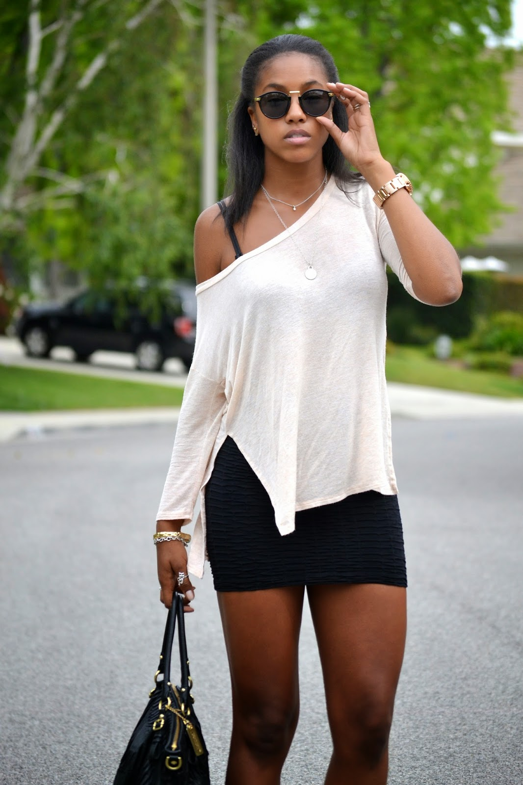 Style an oversized off the shoulder top with a mini skirt
