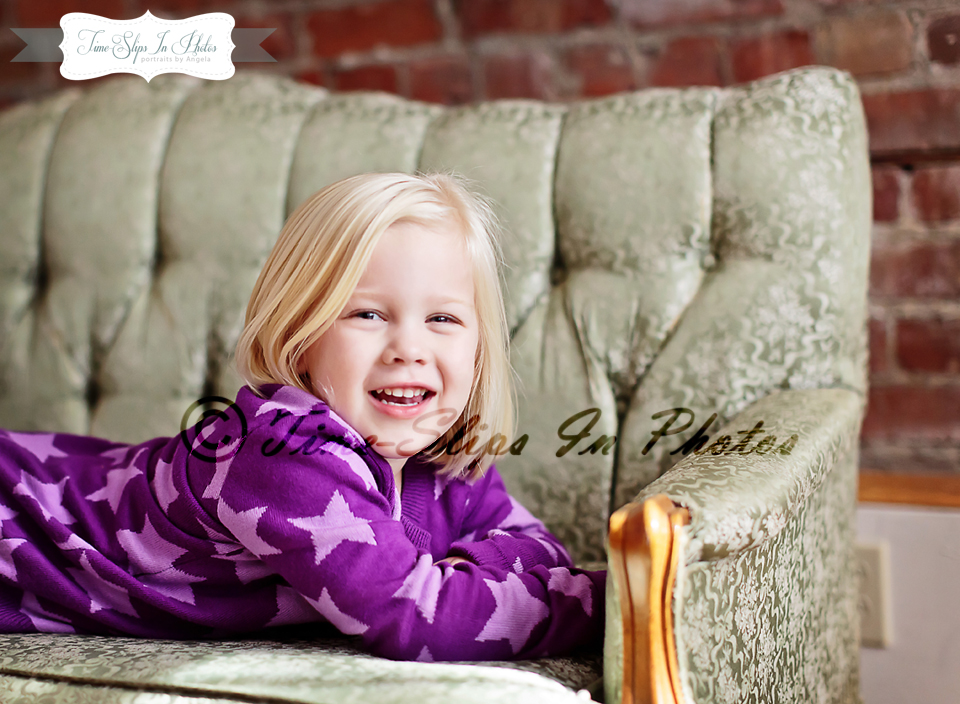 blond_toddler_girl_ornate_sofa