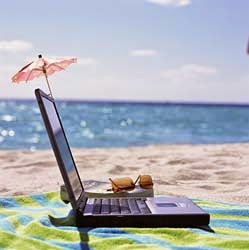 laptop enjoying a day at the beach