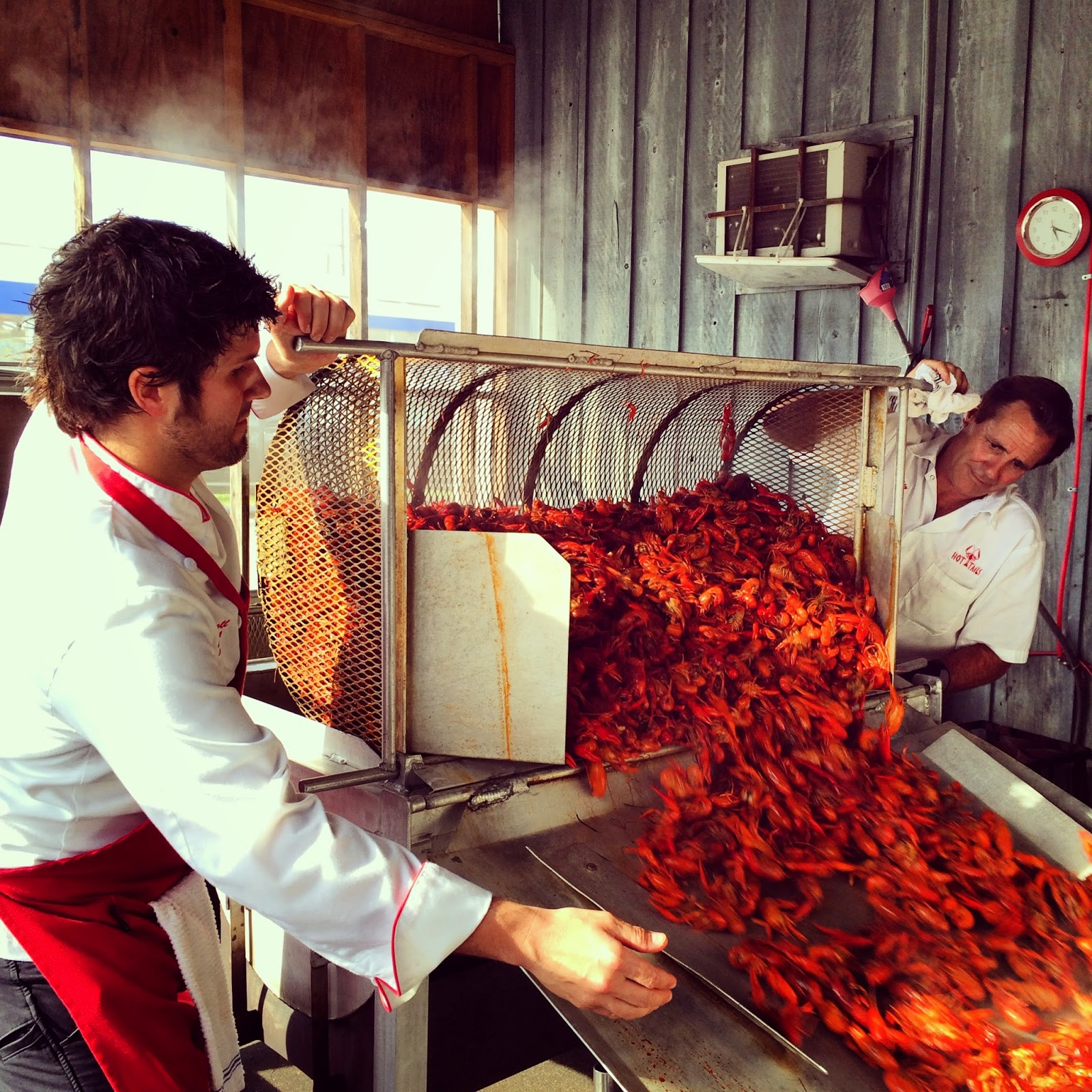 I caught Chef Cory Carroll (left) pulling out a fresh batch  of his famous boiled crawfish.