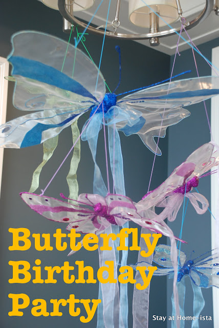 Butterfly birthday party with hanging butterfly decorations