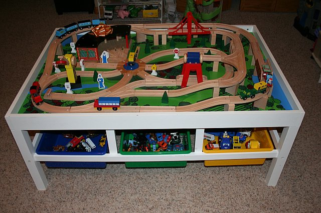 Then I Bought A Train Track Set On Amazon, We Set It Up On Christmas Eve  After The Boys Went To Bed, And Voila! Our Own Train Table.