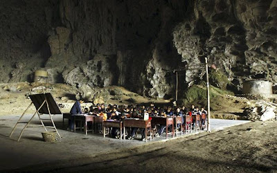 Children attend class at the Dongzhong (literally means in cave) primary school at a Miao village in  Ziyun county, southwest China's Guizhou province. The school is built in a huge, aircraft hanger-sized natural cave, carved out of a mountain over thousands of years by wind, water and seismic shifts.Picture: REUTERS/China Daily