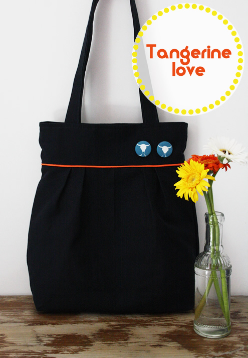 Navy blue pleated tote bag with tangerine piping