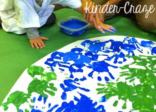 giant handprint painting of the Earth