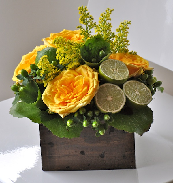 Roses Hypericum Berries Galax Solidaster And Cut Limes Make Up This Cheerful Rustic Floral Design Learn How To Preserve Citrus For