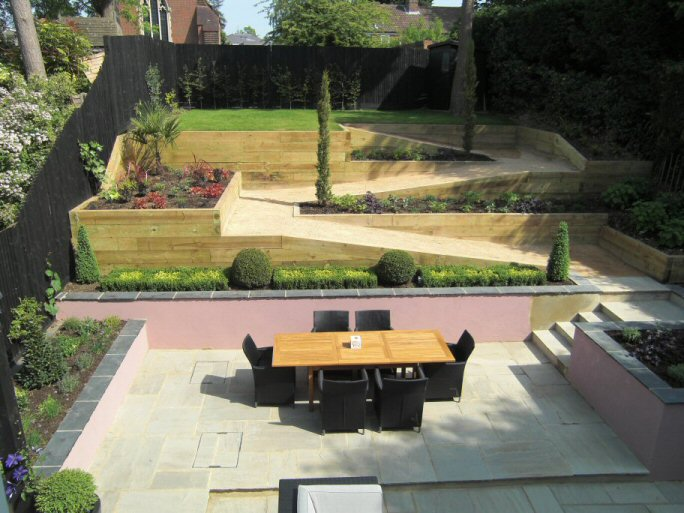 life designing steeply sloping garden design in gerrards cross