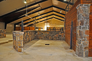 Custom Horse Barn Covered Riding Arena Hay Gated Entrance And Equestrian Facility