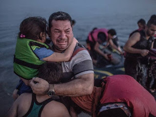 http://www.independent.co.uk/news/world/europe/kos-crisis-the-story-behind-the-photograph-of-a-syrian-father-shared-by-thousands-online-10461933.html