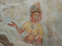 Sigiriya ancient fresco, graffiti, charming, beautiful Lankan Lady, painstakingly rendered features, facial expressions, hats, jewelry, flowers