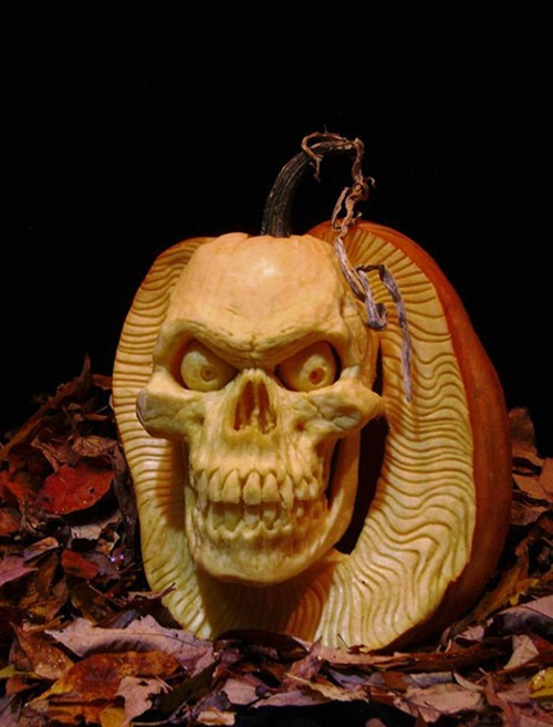 Halloween with scary pumpkin carvings by ray villafane