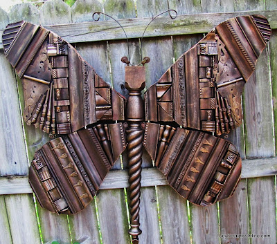 giant butterfly with picture molding design recycled art