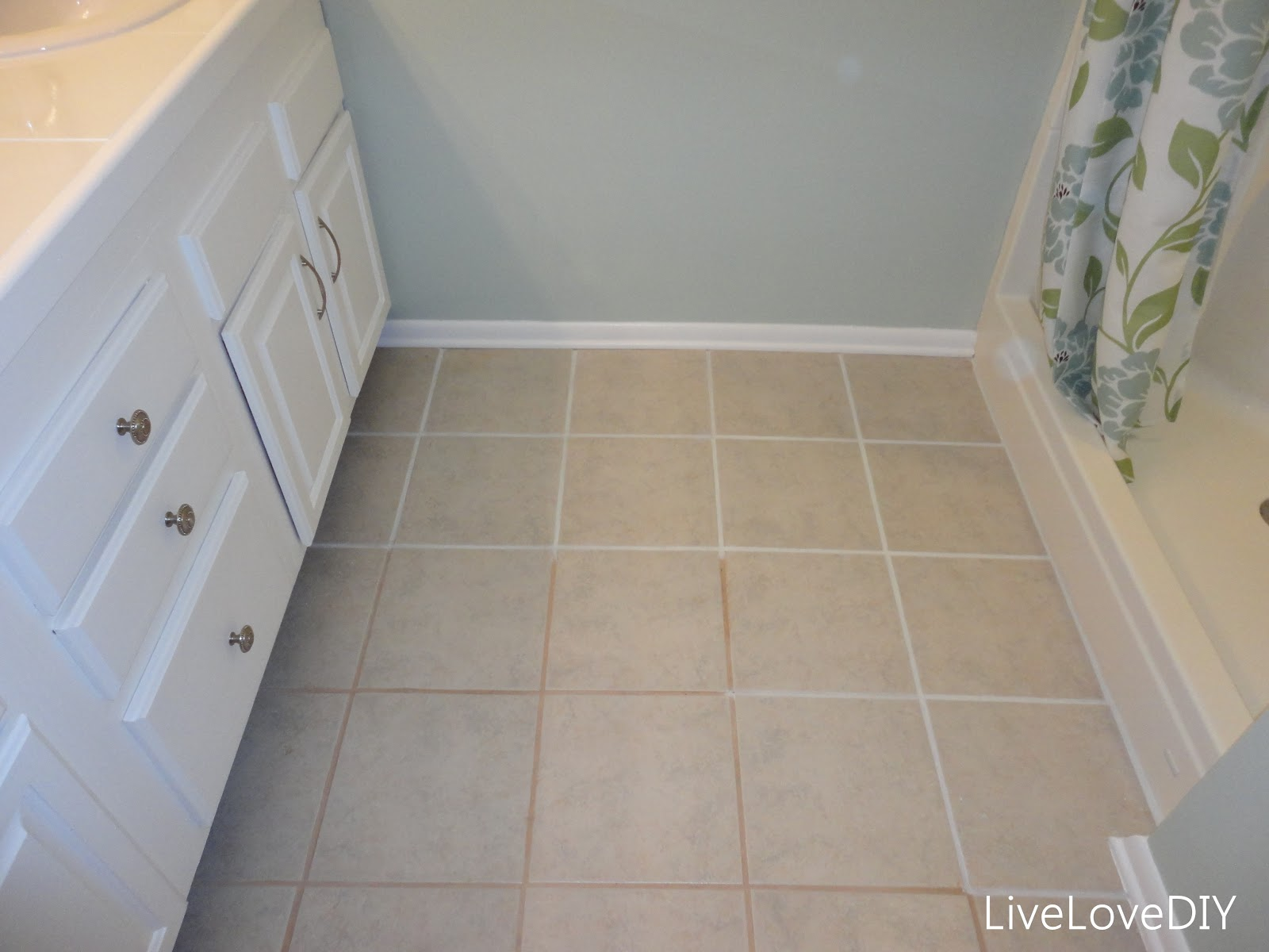 including how to paint tile grout and how to frame in a mirror