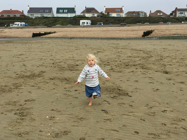 Tin Box Tot running on the sand