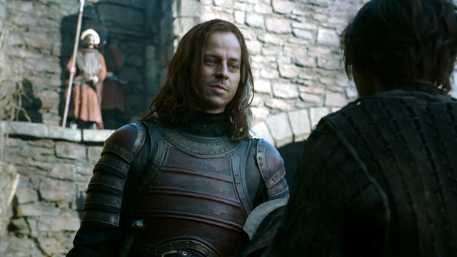 A still from Game of Thrones, Season 2, with actors playing Jaqen H'ghar and Arya Stark.
