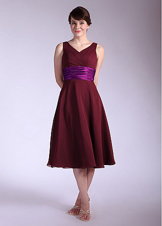 69719f9058 The empire waist with tea length skirt complete the look.The back comes  with zipper-up closure. V-neck Tea Length Oxblood Bridesmaid Dress