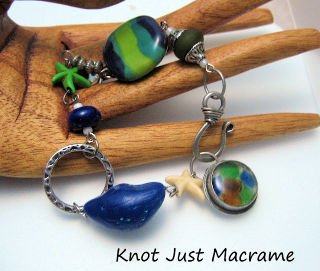 Bracelet using Windbent polymer clay bird, sea glass and resin clasp, Kazuri bead, lampwork spacers and dyed howlite starfish.