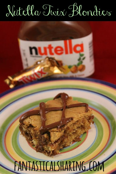 Nutella Twix Blondies | A chewy, soft dessert with Twix inside and Nutella on top!