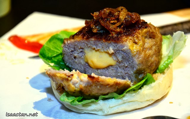 Check out the cheese oozing out from the centre of the pork patty