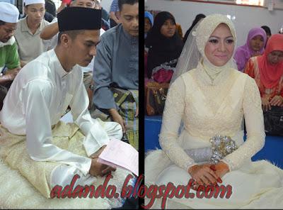 Pasangan pegantin mengenakan busana warna krim.