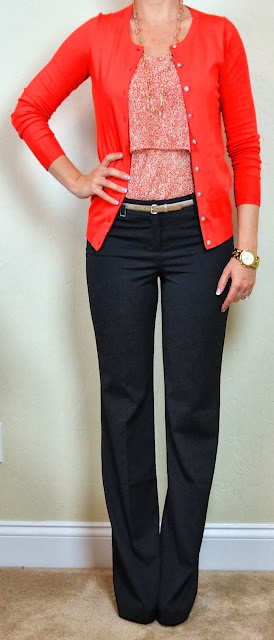 Red floral tiered camisole, red cardigan, black editor pants and golden wrist watch