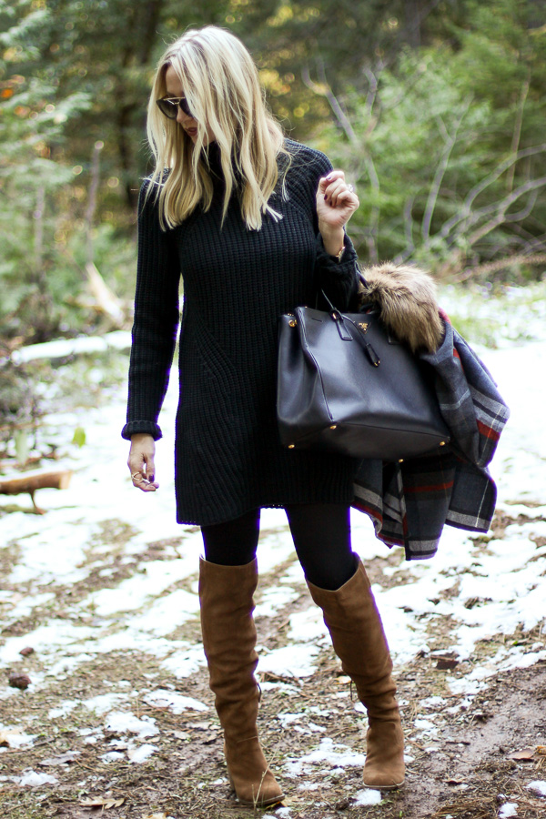 black sweater dress black tights black tote cognac boots