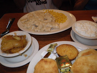 Chicken and dumplings with corn, fried apples and cottage cheese. The biscuits and corn muffins are on a communal platter.