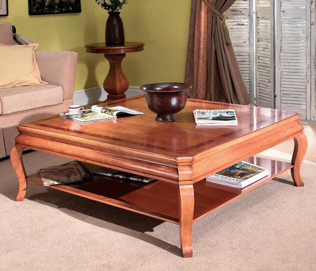 bright brown cherry wood coffee table with simple vase on top in the modern living room