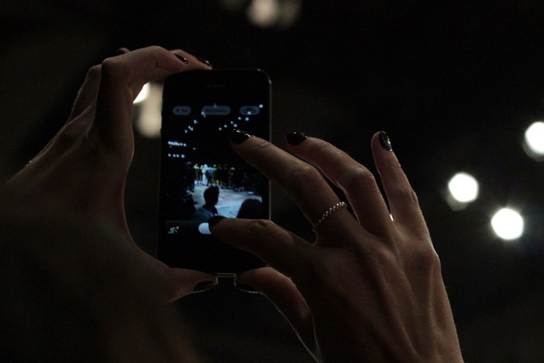 taking pictures during the show, picture of an iphone you can see the show on the screen, copenhagen fashion week