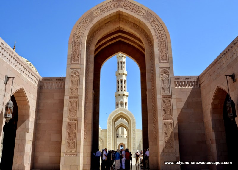 Sultan Qaboos Grand Mosque's marble arches and minaret