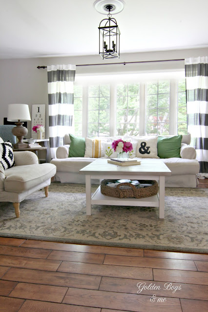 Living Room with striped drapes and Ikea furniture-www.goldenboysandme.com