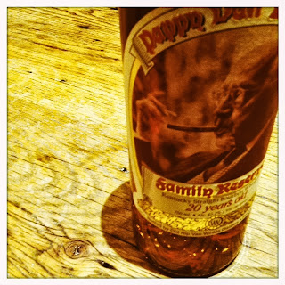 image of 20 year pappy van winkle placed on a reclaimed barn wood table