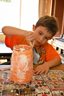 child adding glue