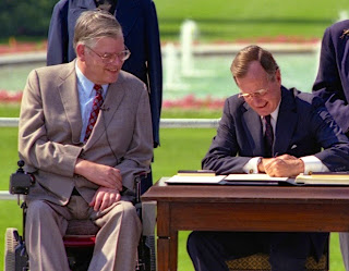 Evan Kemp watches as George H.W. Bush signs the ADA