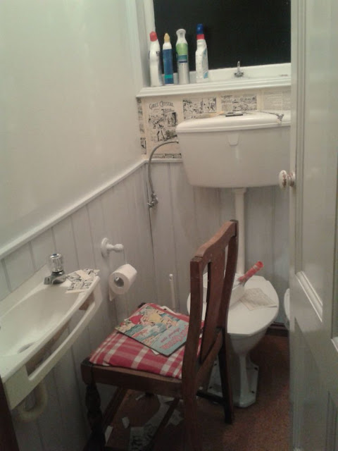 Mum DIY in the middle of the night - wallpapering the toilet