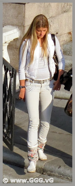 Girl in white pants on the street