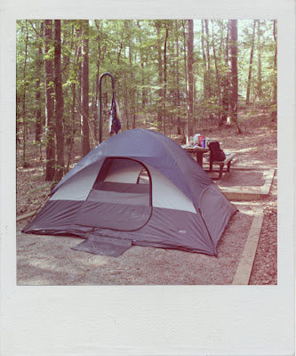 a dome tent in the woods polaroid