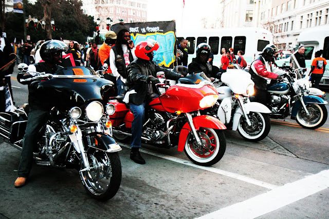 A group of protesters riding motorcycles through downtown Oakland.