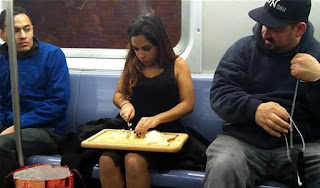funny picture lady sitting to eat in the New York subway