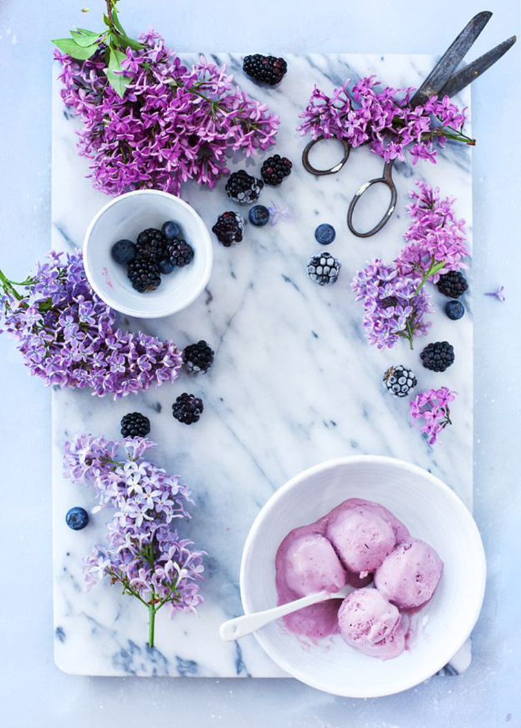 Lilac lavender flowers, blueberries and blackberries, lavender ice cream, marble cutting board