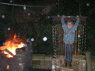 throwing an old bead curtain on the bonfire