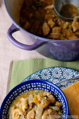 A hearty white chili recipe with cubes of roasted pumpkin and spicy Hatch chiles, chunks of chicken breast, and creamy white beans in a beer-spiked broth.