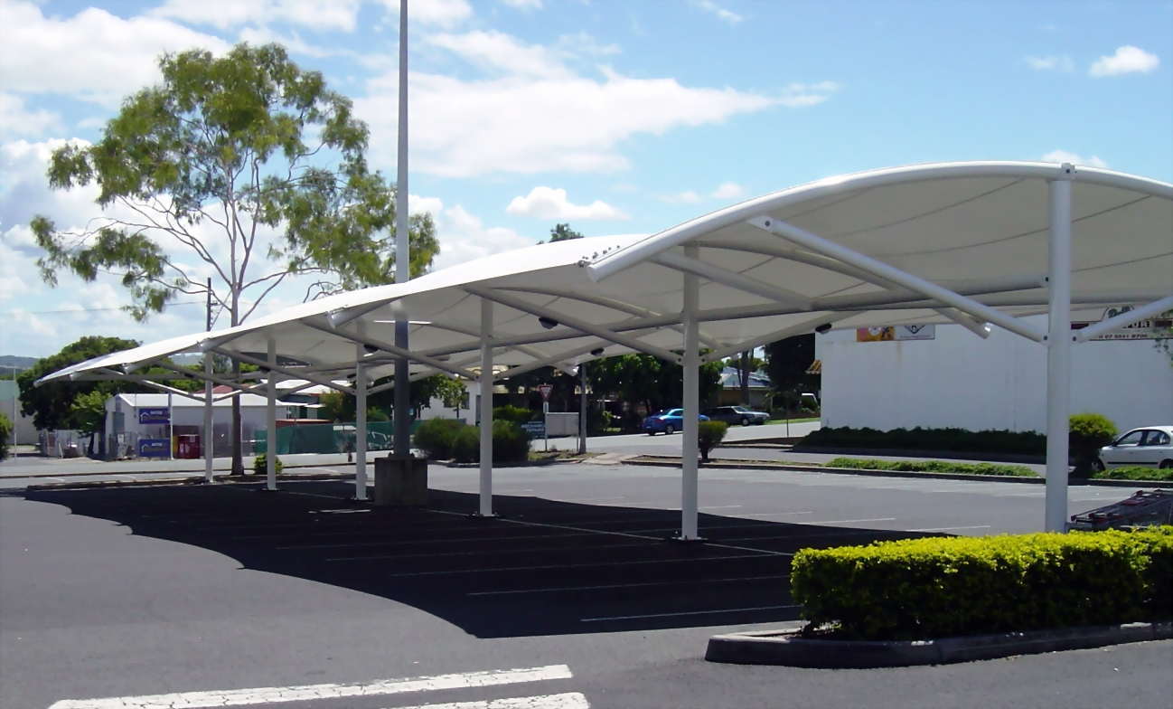 Car parking shades suppliers in qatar car parking shades for Sun shade structure