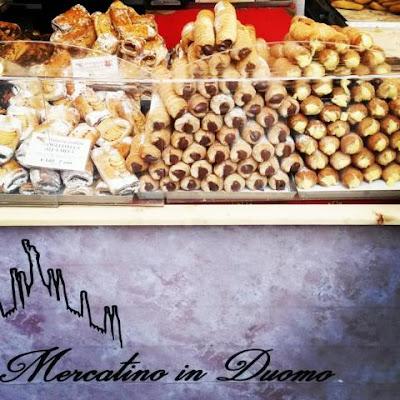 Cannoli auf dem Weihnachtsmarkt in Mailand