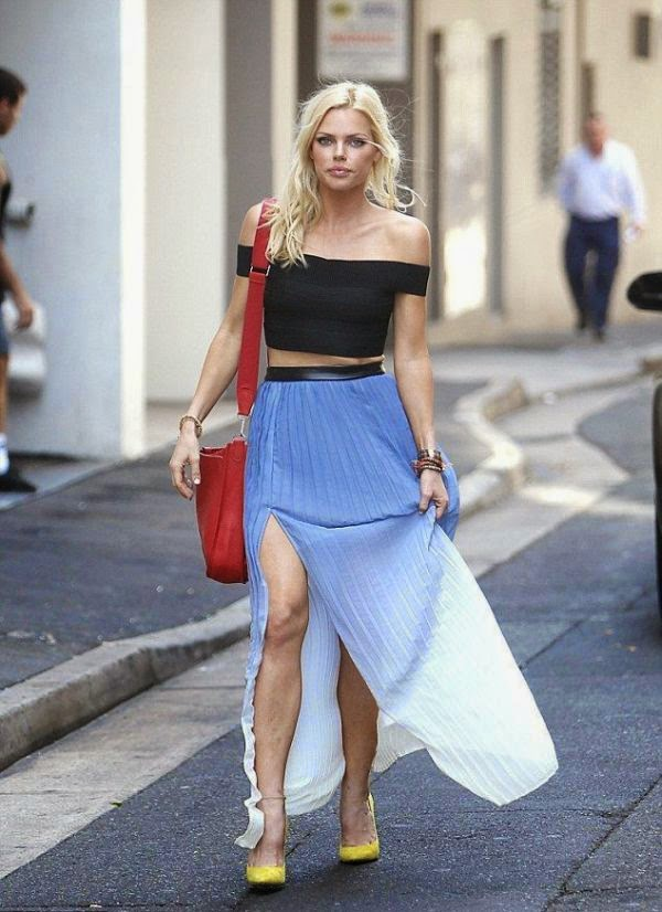 Okay, seriously, Sophie Monk is just to perfect, and she makes look up her age every time because there's now way she can be 35!  The stunning brunette strolling by herself on the street at King Cross in Sydney, Australia on Monday, December 22, 2014 and showing her incredible in a dark lower top and blue maxi skirt.