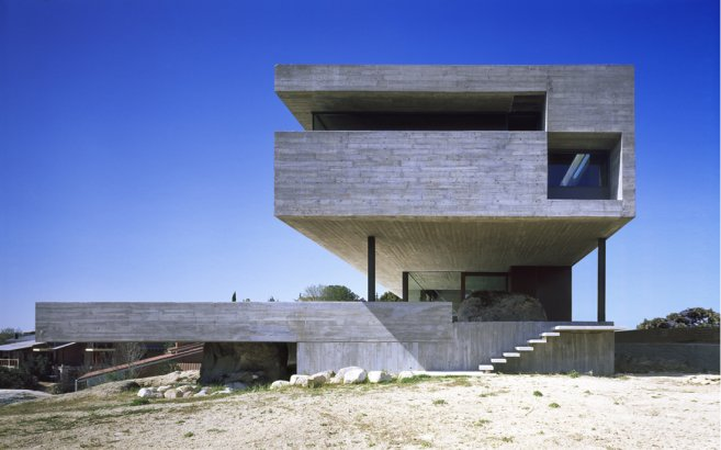 The Modern Concrete Home Situated On The Slope Oriented To The South Not  Far From Madrid, Spain. Overhanging Part Of The Facade On The Front Side Of  The ...